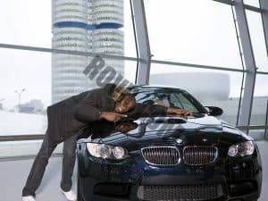 A happy customer (Usain Bolt) taking delivery of a new BMW
