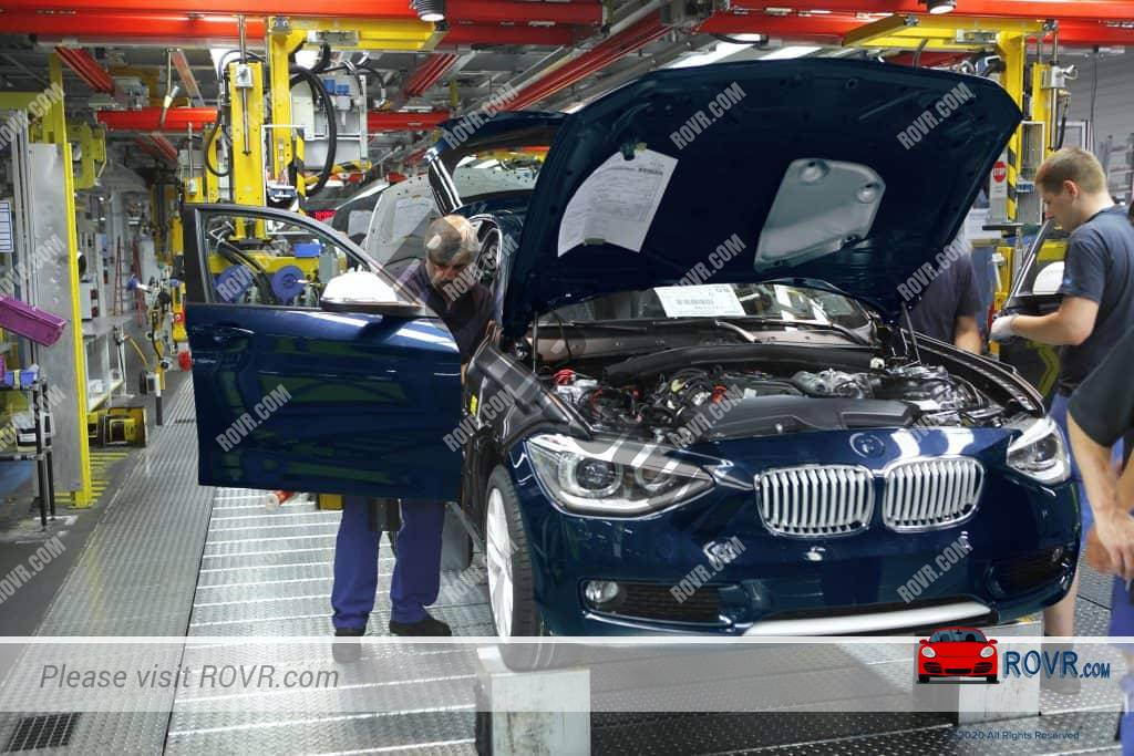 Employees assembling vehicles at the BMW Factory