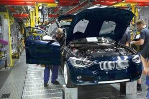BMW Employees assembling cars on production line