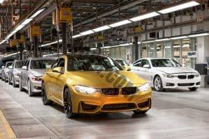 A line of completed BMW cars on the factory line