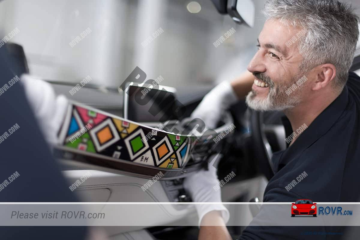 Employee installing BMW Individual paneling into 7-Series