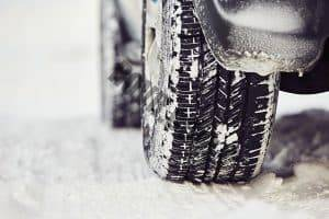 Tires on the snowy road in Winter